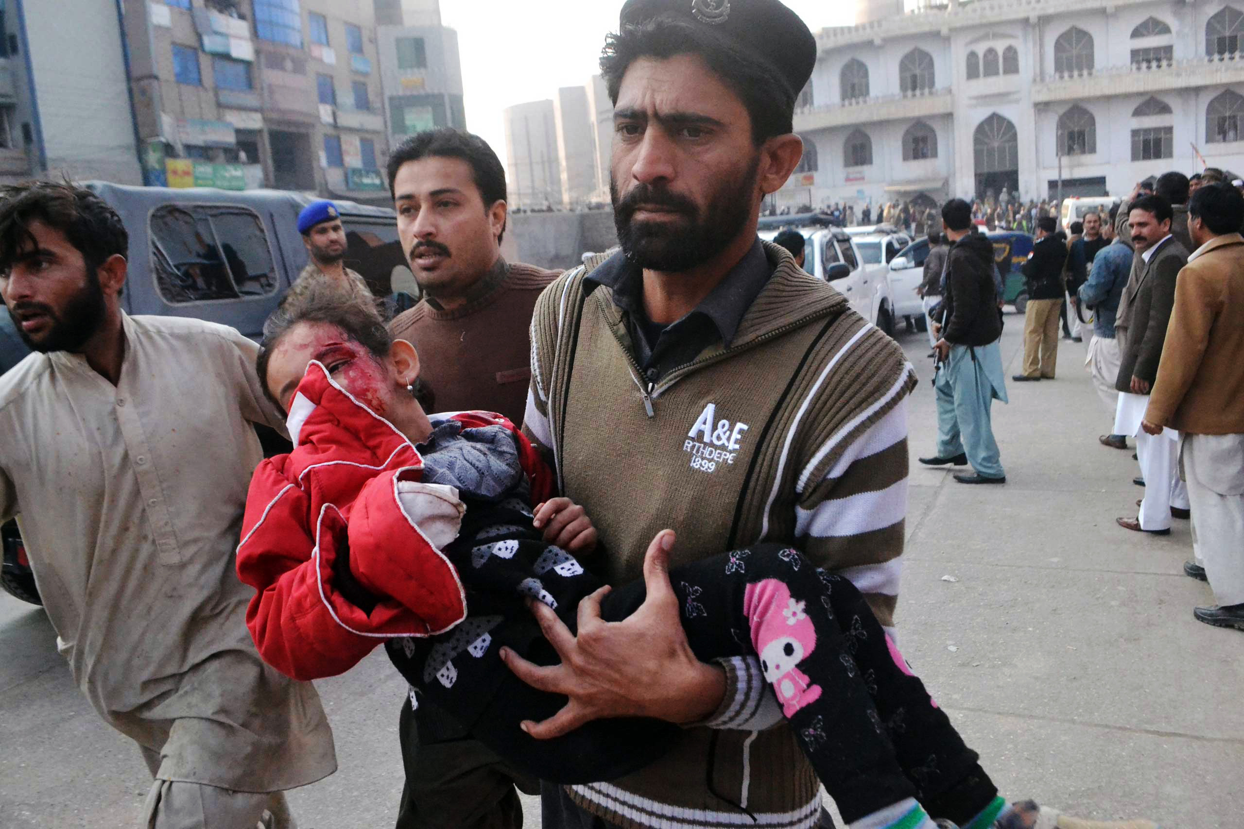 A Pakistani girl, who was injured in a Taliban attack in a school, is rushed to a hospital in Peshawar, Pakistan, Tuesday, Dec. 16, 2014. Taliban gunmen stormed a military-run school in the northwestern Pakistani city of Peshawar on Tuesday, killing and wounding scores, officials said, in the highest-profile militant attack to hit the troubled region in months.(AP Photo/Mohammad Sajjad)